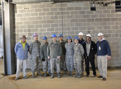 Col. Steven H. Benden, Mission Support Group Commander (center) and several of buildings the new occupants pose for a group photo after a short tour of the new 175th Wing Headquarters, Mission Support Group and Medical Group facility at Warfield Air National Guard Base, Baltimore, Md. This 26,000-sq-ft, $11.8 million building will feature multiple green roofs and is anticipated to achieve certified LEED Silver status with the numerous energy enhancement measures upon its completion. The building will house offices, medical/dental examination and treatment space, classrooms, administration space, command section, conference rooms, telephone switching/data automation center as well as utility systems services and connections.