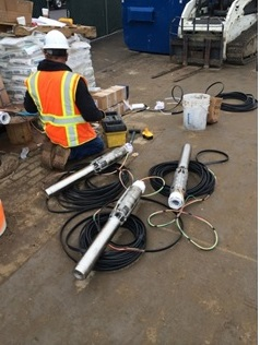 Electrical submersible pumps were placed near the bottom of each dewatering well.